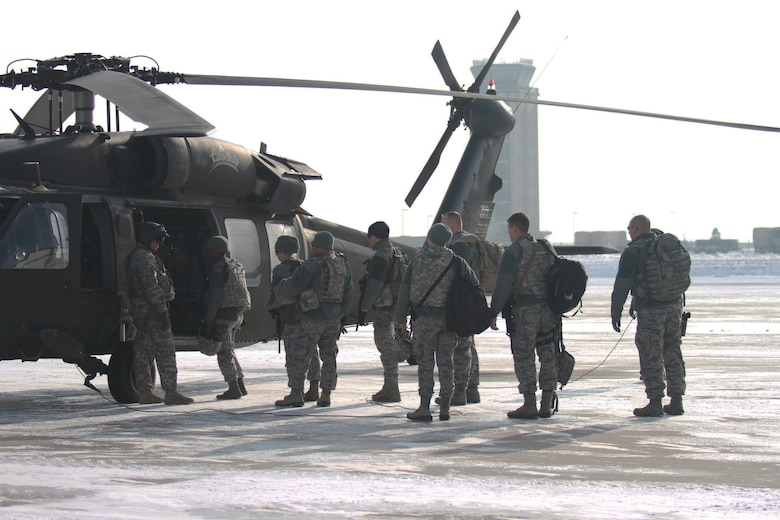 U.S. Airmen from the Colorado National Guard's 140th Security Squadron board a UH-60 Black Hawk helicopter in support of a blizzard response exercise at Buckley Air Force Base, Aurora, Colo., Jan. 9, 2016. Colorado Guard members and various local agencies are participating in a blizzard response exercise with local authorities this week. (U.S. National Guard photo by Spc. Ashley Low/)