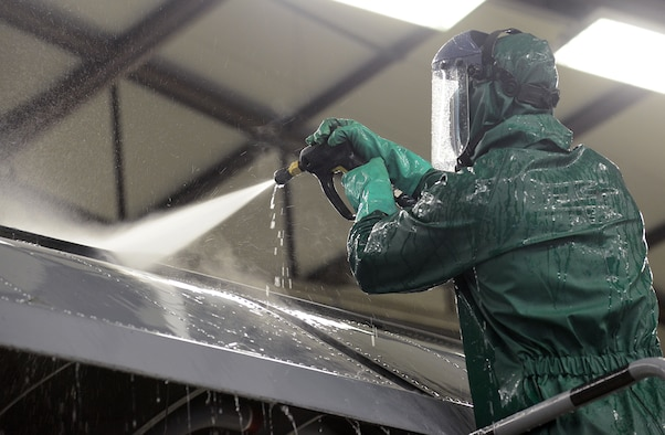Airman Drew Thurau, 86th Maintenance Squadron crew chief, sprays water on the wing of a C-130J Super Hercules during a pre-isochronal (ISO) inspection wash Jan. 4, 2016, at Ramstein Air Base, Germany. An ISO inspection is a scheduled, extensive examination of an aircraft to maintain its functionality and perform preventive maintenance. (U.S. Air Force photo/Staff Sgt. Timothy Moore)