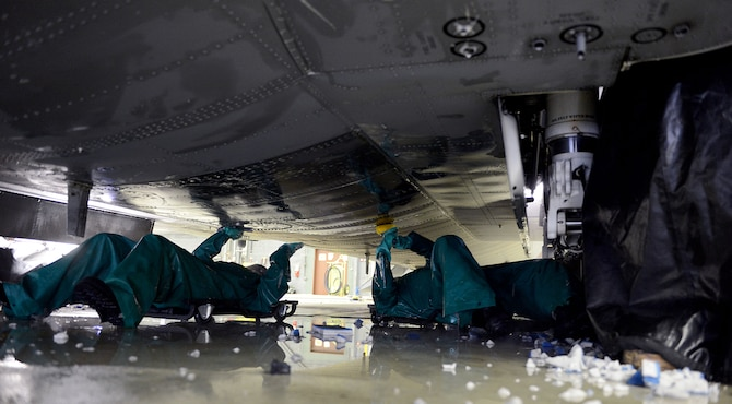Capt. Rachel Weiler, left, 86th Maintenance Squadron maintenance flight commander, and Senior Airman Kyle Warnock, 86th MXS crew chief clean the underbelly of a C-130J Super Hercules during a pre-isochronal (ISO) inspection wash Jan. 4, 2016, at Ramstein Air Base, Germany. An ISO inspection is a scheduled, extensive examination of an aircraft to maintain its functionality and perform preventive maintenance. This examination marks the 14th and final C-2 ISO inspection, which is the most in-depth ISO inspection, for the 86th Airlift Wing until 2020. The inspection lasts approximately two weeks. (U.S. Air Force photo/Staff Sgt. Timothy Moore)