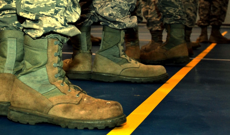 A row of boots belonging to new 111th Attack Wing Honor Guard members resemble the attempt at executing facing movement during the first official practice as a newly-renovated team Jan. 9, 2015 on the base basketball court at Horsham Air Guard Station, Pennsylvania. The team now has 17 members, but is actively recruiting more Guardsmen who wish to be committed to the honor guard. (U.S. Air National Guard photo/Tech. Sgt. Andria Allmond)