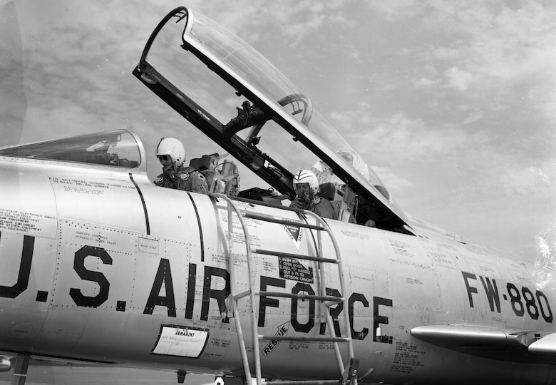 Lt. Col. Warren G. Nelson, 185th Tactical Fighter Group returns from a flight in an F-100F while Iowa Governor Harold Hughes rides in the back seat at the Volk Filed Combat Readiness Training Center in Wisconsin on July 22, 1966. Hughes was treated to a backseat ride in the two seat training model of the F-100 while visiting the unit during their annual summer training. The F-100, tail number 880, was assigned to the Iowa National Guard's 185th Tactical Fighter Group in Sioux City, Iowa. U.S. Air National Guard Photo by Airman 1st Class Dwain Volwieler 185th TFG Photographer