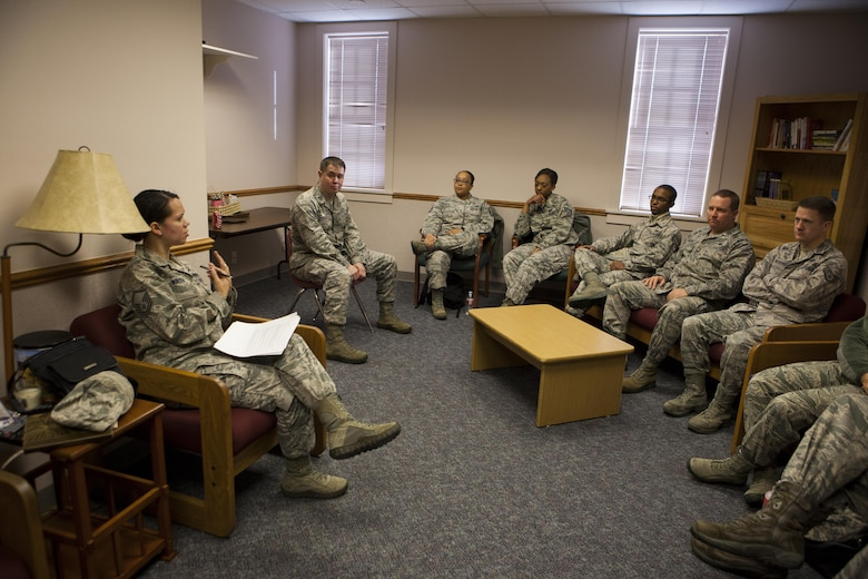 MSgt. Gloria Wilson, 90th Missile Wing Public Affairs superintendant, discusses a safety scenario with a group of wing staff personnel on F.E. Warren Air Force Base, Wyo., Jan. 11, 2016, during a 20th Air Force Safety Down-Day. The down day was part of a 20th Air Force wide initiative to reinforce safety as a high priority. (U.S. Air Force photo by Lan Kim)
