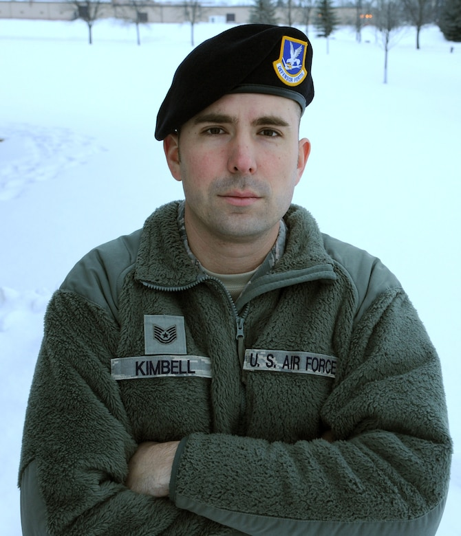 Tech. Sgt. Brent Kimbell, 319th Security Forces Squadron NCO-in-charge of anti-terrorism, poses in the snow Jan. 13, 2016, on Grand Forks Air Force Base, North Dakota. Kimbell was named the Air Force Outstanding Security Forces Flight Level NCO for 2015. (U.S. Air Force photo by Airman 1st Class Ryan Sparks/Released)
