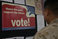 Posters encouraging Marines to engage the political systems they defend hang in various locations throughout Marine Corps Base Camp Lejeune. According to DoD Directive 1344.10, Political Activities by Members of the Armed Forces, it is the policy to encourage DoD civilians and active duty members to carry out the obligations of citizenship without endorsing or implying an endorsement for a political party.  (Courtesy photo)