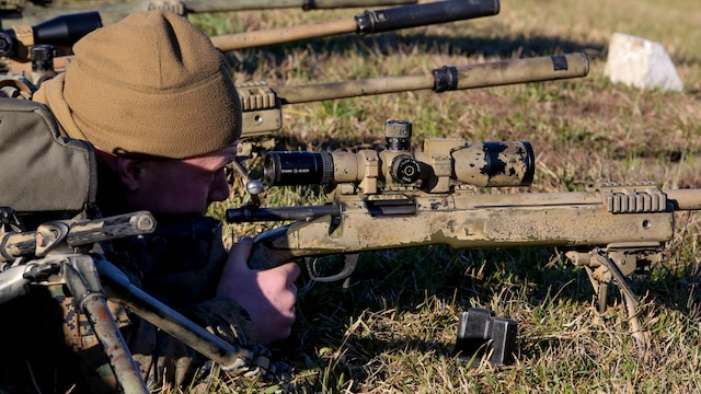 A Marine student undergoing the 2nd Marine Division Combat Skills Center Pre-Scout Sniper Course sights in on a target with a M40A5 sniper rifle at Marine Corps Base Camp Lejeune, North Carolina, Jan. 12, 2016. The 2nd Marine Division Combat Skills Center offers several infantry-based courses to enhance the combat readiness of its Marines.