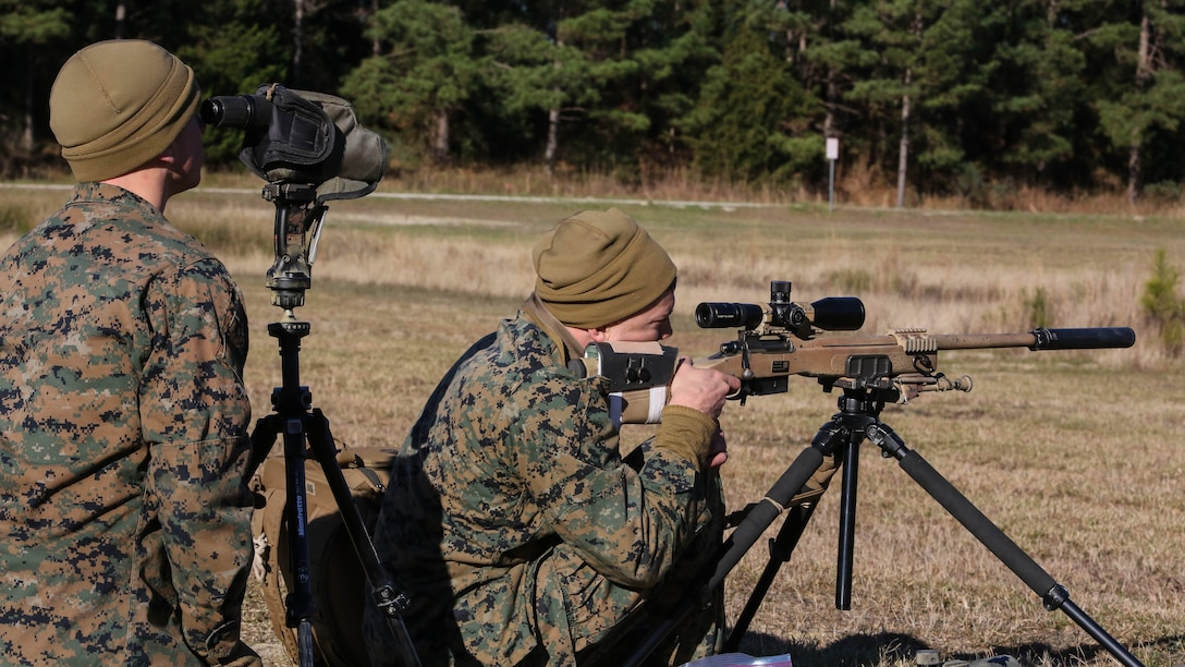 Marine students undergoing the 2nd Marine Division Combat Skills Center Pre-Scout Sniper Course prepare to engage targets with the M40A5 sniper rifle at Marine Corps Base Camp Lejeune, North Carolina, Jan. 12, 2016. Students worked in teams of two, executing roles as a spotter or a shooter, to engage targets between 300 and 1000 meters away.