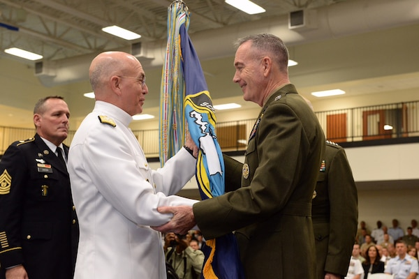 Marine Corps Gen. Joseph F. Dunford Jr., chairman of the Joint Chiefs of Staff, passes command of U.S. Southern Command to Navy Adm. Kurt W. Tidd at the command's headquarters in Miami, Jan. 14, 2016. Tidd assumed command from retiring Marine Corps Gen. John F. Kelly. DoD photo by EJ Hersom