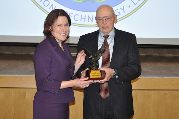 Pictured from left, Defense Procurement and Acquisition Policy Director Claire Grady presents Donald Peschka with the 2015 Under Secretary of Defense for Acquisition, Technology and Logistics Acquisition and Contracting Legends Award during a ceremony at the Pentagon Jan. 12.