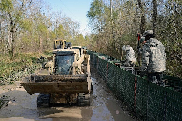 The Louisiana National Guard continues to work around the clock, constructing HESCO barrier levees on Avoca Island, Louisiana, Jan. 11, 2016. The project will prevent backwater flooding from reaching Morgan City and other towns in south Louisiana due to high river levels.