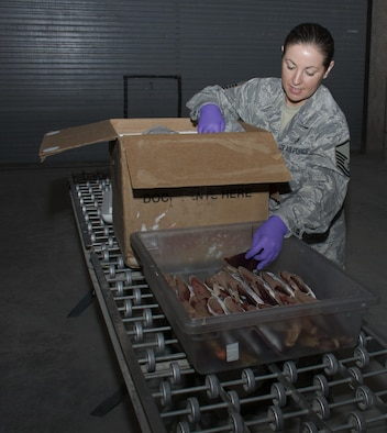 Master Sgt. Stephanie Washington, a 379th Expeditionary Medical Support Squadron diagnostics and therapeutics flight chief, carefully packs red blood cell units for shipment inside the Blood Transshipment Center at Al Udeid Air Base, Qatar, Jan. 13, 2016. The center shipped nearly 23,000 units of blood to more than 30 forward operating locations in the U.S. Central Command area of responsibility in 2015. (U.S. Air Force photo/Tech. Sgt. James Hodgman)