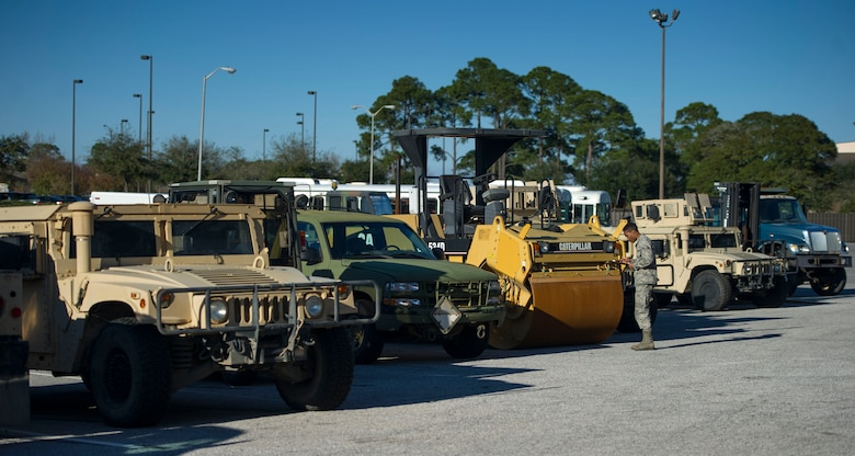 Airman 1st Class Jordan Artis, a vehicle management analysis journeyman with the 1st Special Operations Logistics Readiness Squadron, performs a yard check on Hurlburt Field, Fla., Jan. 12, 2016. Yard checks are conducted to ensure vehicles are accounted for. (U.S. Air Force photo by Senior Airman Krystal M. Garrett)