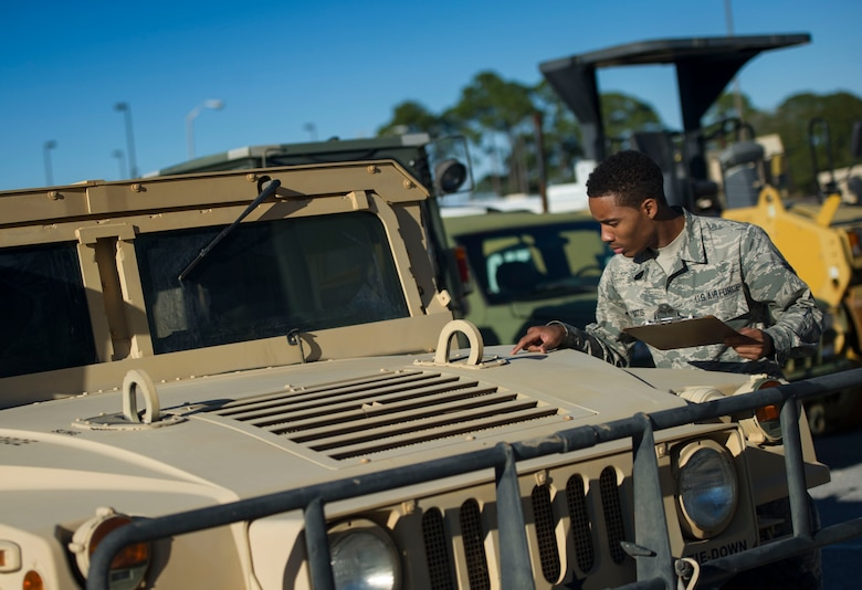 Airman 1st Class Jordan Artis, a vehicle management analysis journeyman with the 1st Special Operations Logistics Readiness Squadron, performs a yard check on Hurlburt Field, Fla., Jan. 12, 2016. There are approximately 100 different types of vehicles assigned to units at Hurlbrt. (U.S. Air Force photo by Senior Airman Krystal M. Garrett)