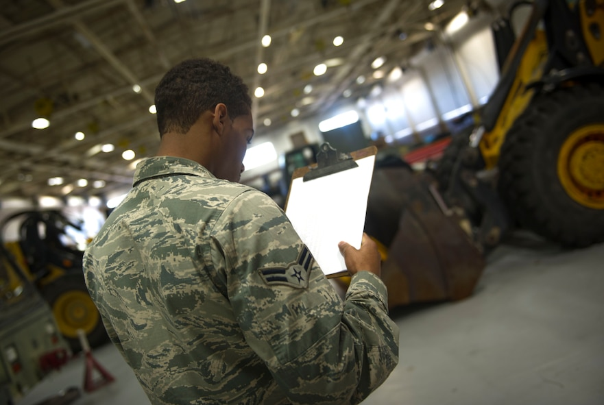 Airman 1st Class Jordan Artis, a vehicle management analysis journeyman with the 1st Special Operations Logistics Readiness Squadron, performs a yard check on Hurlburt Field, Fla., Jan. 12, 2016. A yard check is conducted to ensure all vehicles are accounted for. (U.S. Air Force photo by Senior Airman Krystal M. Garrett)