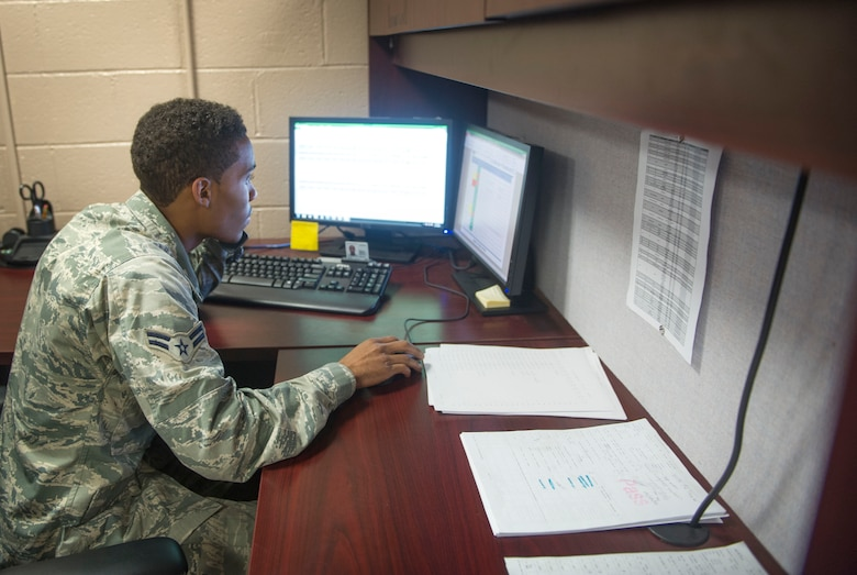 Airman 1st Class Jordan Artis, a vehicle management analysis journeyman with the 1st Special Operations Logistics Readiness Squadron, speaks with a unit Vehicle Control Officer on Hurlburt Field, Fla., Jan. 12, 2016. The Sterling, Va. native is in charge of the VCO program. (U.S. Air Force photo by Senior Airman Krystal M. Garrett)
