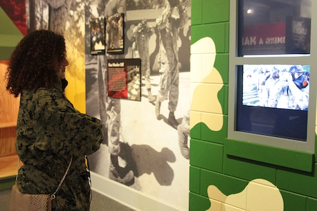 Mya Russi, an assistant principal at Freedom High School and part of the Recruiting Station Orlando group, watches a video based around the time recruits go through the crucible section of training in the Parris Island Museum January 14, 2016, aboard Marine Corps Recruit Depot Parris Island, S.C. Visiting the Parris Island Museum is one of the many parts of the Educators Workshop, which is a three-day event that will give the educators a chance to experience the day-to-day routines aboard the depot and Marine Corps Air Station Beaufort, S.C. The purpose of the workshop is to give the educators a better understanding of the Marine Corps. (Official Marine Corps photo by Cpl. Diamond Peden)