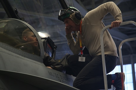Ken Allen, a teacher from Hudson High School and part of the Recruiting Station Orlando group, speaks with one of the pilots at the hangar January 13, 2016, aboard Marine Corps Air Station Beaufort, S.C. The three-day workshop will give the educators a chance to experience the day-to-day routines aboard the depot and Marine Corps Air Station Beaufort, S.C. The purpose of the workshop is to give the educators a better understanding of the Marine Corps. (Official Marine Corps photo by Cpl. John-Paul Imbody)