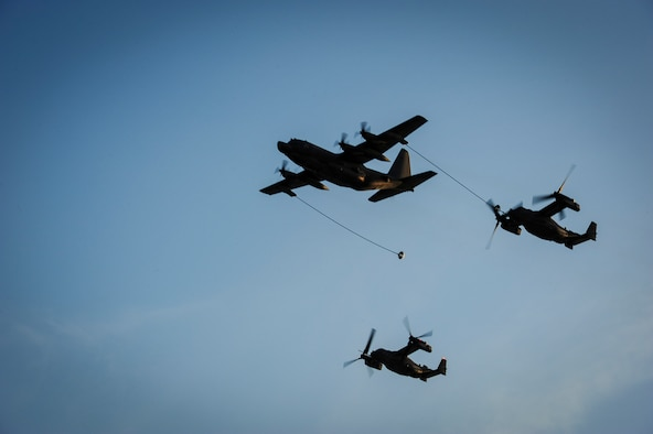 An MC-130H Combat Talon refuels a CV-22B Osprey during the honorary commanders change of command ceremony on Hurlburt Field, Fla., Sept. 25, 2015. The honorary commander program allows local community leaders frequent opportunities to visit Hurlburt Field and learn about the mission, participate in base functions and to express their views on issues of mutual concern. (U.S. Air Force photo by Senior Airman Meagan Schutter)