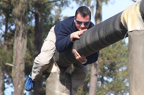Daniel Myers, a history teacher from Haines City High School and part of the Recruiting Station Orlando group, attempts to finish the obstacle named Dirty Name, one of the many obstacles that make up the Confidence Course, aboard Marine Corps Recruit Depot Parris Island, S. C., January 14, 2016. The teachers, coaches and principals are part of a larger group of 80 high school educators from Florida selected to participate in a three-day workshop designed to inform educators about military service and life in the Marine Corps. (Official Marine Corps photo by Cpl. John-Paul Imbody)