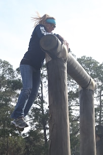 Sharon Remy, a teacher from Dr. Phillips High School and part of the Recruiting Station Orlando group, jumps up to the top of an obstacle named Dirty Name, one of the many obstacles that make up the Confidence Course, aboard Marine Corps Recruit Depot Parris Island, S. C., January 14, 2016. The teachers, coaches and principals are part of a larger group of 80 high school educators from Florida selected to participate in a three-day workshop designed to inform educators about military service and life in the Marine Corps. (Official Marine Corps photo by Cpl. John-Paul Imbody)