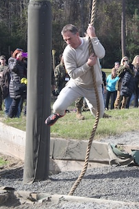 Ken Allen, a teacher from Hudson High School and part of the Recruiting Station Orlando group, swings across the ditch below in one of the obstacles that make up the Confidence Course, aboard Marine Corps Recruit Depot Parris Island, S. C., January 14, 2016. The teachers, coaches and principals are part of a larger group of 80 high school educators from Florida selected to participate in a three-day workshop designed to inform educators about military service and life in the Marine Corps. (Official Marine Corps photo by Cpl. John-Paul Imbody)