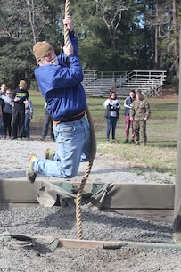Mark McCatty, a leadership coach and part of the Recruiting Station Orlando group, swings across the ditch below in one of the obstacles that make up the Confidence Course, aboard Marine Corps Recruit Depot Parris Island, S. C., January 14, 2016. The teachers, coaches and principals are part of a larger group of 80 high school educators from Florida selected to participate in a three-day workshop designed to inform educators about military service and life in the Marine Corps. (Official Marine Corps photo by Cpl. John-Paul Imbody)