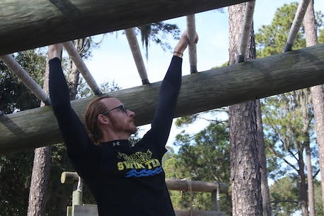Michael Wilde, a teacher from Blake High School and part of the Recruiting Station Orlando group, reaches for one of the bars of the monkey bars, one of the obstacles that make up the Confidence Course, aboard Marine Corps Recruit Depot Parris Island, S. C., January 14, 2016. The teachers, coaches and principals are part of a larger group of 80 high school educators from Florida selected to participate in a three-day workshop designed to inform educators about military service and life in the Marine Corps. (Official Marine Corps photo by Cpl. John-Paul Imbody)