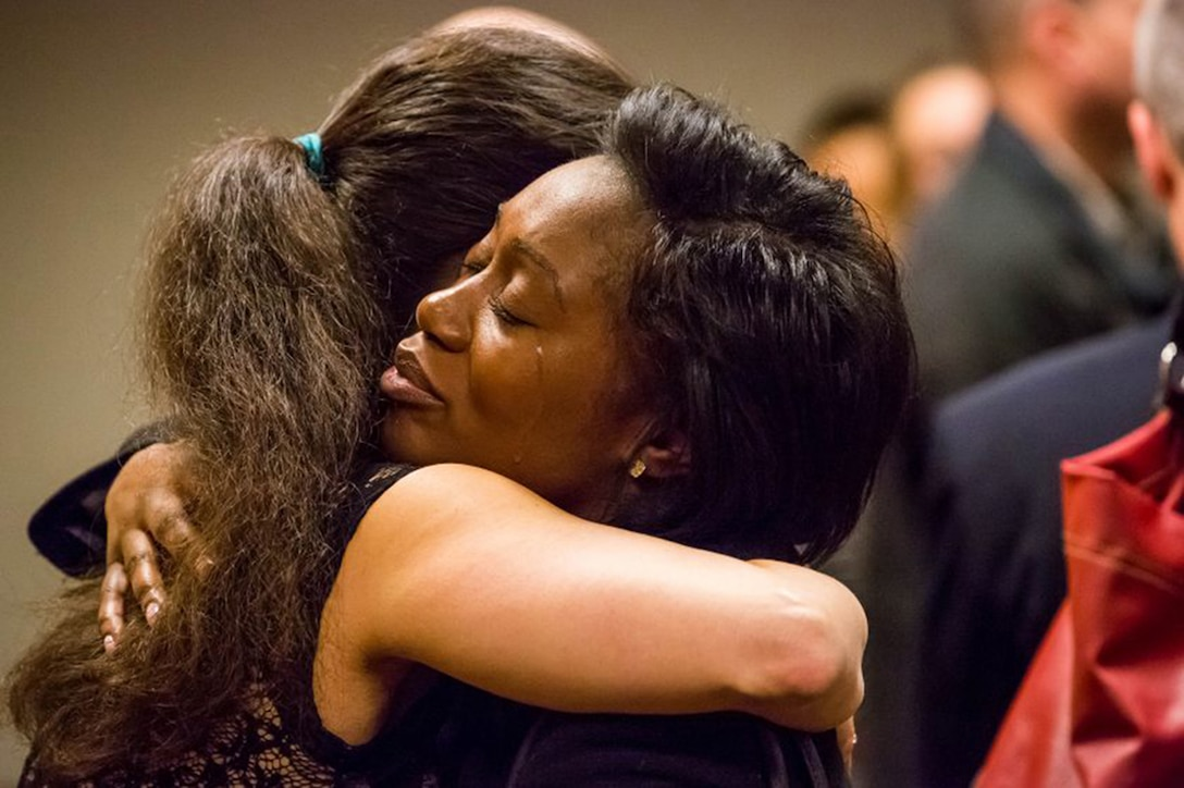 Jamaesha Sweatt (right) hugs Deborah Wyatt in an Anchorage, Alaska, courtroom. Wyatt's son, Lane, was sentenced to nearly two decades in prison for the drunk-driving death of Sweatt's sister, Citari Townes-Sweatt. (Courtesy photo by Loren Holmes/ Alaska Dispatch News)