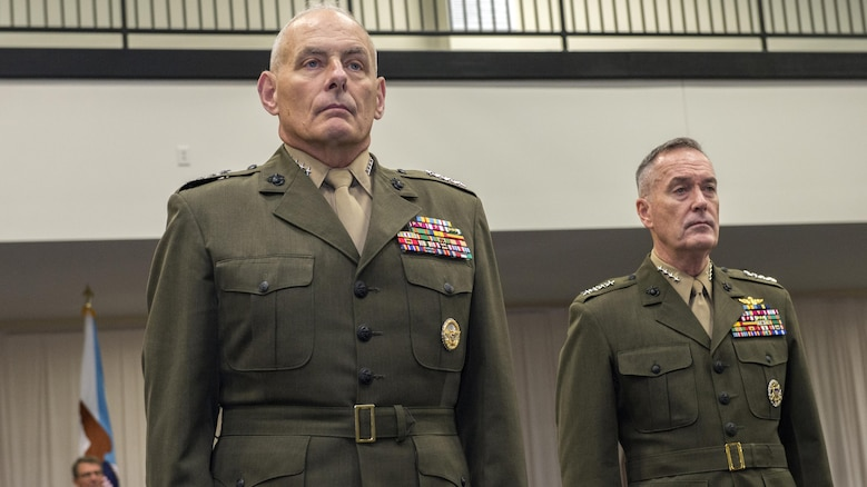 U.S. Marine Gen. John F. Kelly, left, and U.S. Marine Corps Gen. Joseph F. Dunford, chairman of the Joint Chiefs of Staff, stand at attention during the U.S. Southern Command change of command ceremony at SOUTHCOM headquarters in Doral, Fla., Jan. 14, 2016. U.S. Navy Adm. Kurt W. Tidd is the new SOUTHCOM commander, succeeding Kelly.
