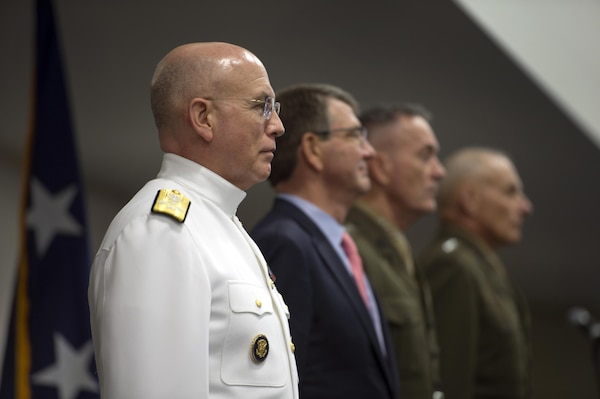 Left to right: Navy Adm. Kurt W. Tidd; Defense Secretary Ash Carter; Marine Corps Gen. Joseph F. Dunford Jr., chairman of the Joint Chiefs of Staff; and Marine Corps Gen. John F. Kelly stand during the change-of-command ceremony for the U.S. Southern Command at the command's headquarter in Miami, Jan. 14, 2016. DoD photo by EJ Hersom