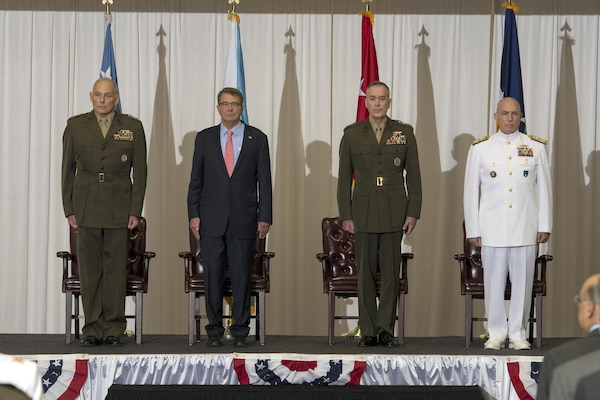 Left to right: Marine Corps Gen. Joseph F. Dunford Jr., chairman of the Joint Chiefs of Staff; Defense Secretary Ash Carter; Marine Corps Gen. John F. Kelly; and Navy Adm. Kurt W. Tidd stand at attention during the change-of-command ceremony at U.S. Southern Command headquarters in Miami, Jan. 14, 2016. DoD News photo by EJ Hersom