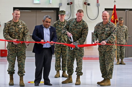 Col. Michael Borgschulte, MAG-39 commanding officer, Sameet Gadi, Balfour Beatty senior vice president, Brig. Gen. Edward D. Banta, MCI-West Commanding General and Col. Ian R. Clark, Marine Corps Air Station Camp Pendleton commanding officer, cut a ribbon to unveil hangar six in MCAS Camp Pendleton, a hangar uniquely designed with the purpose of storing and maintaining MV-22 Ospreys. (U.S. Marine Corps photo by Cpl. Shaltiel Dominguez/ Released)