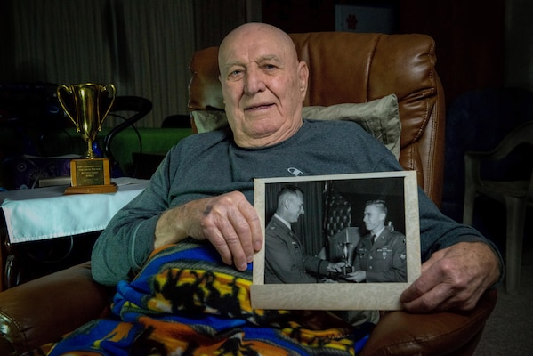 Bill Hill with photo of his son Billy Hill.