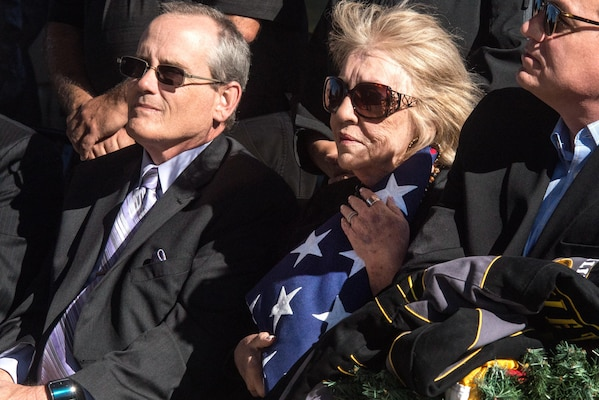 Ms. Beveryly Jacobs, clutches the flag of Sgt. 1st Class Billy David Hill during his full military honors funeral, Killeen, Texas, Dec. 18, 2015. Sergeant Hill was killed in action during the Vietnam conflict Jan 21, 1968 and his remains were later recovered and identified by the Defense POW/MIA Accounting Agency. (DoD photo by Staff Sgt. Erik Cardenas/U.S. Air Force)