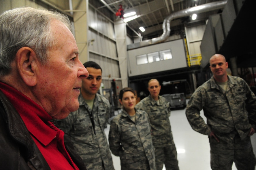 Charlie Brown, the 13th Bomb Squadron Association president, talks to Airmen from the 13th Aircraft Maintenance Unit at Whiteman Air Force Base, Mo., Dec. 17, 2015. The Airmen were educated on how maintenance operations were performed in the past by the veterans as well as about the association's mission. (U.S. Air Force photo by Senior Airman Keenan Berry)