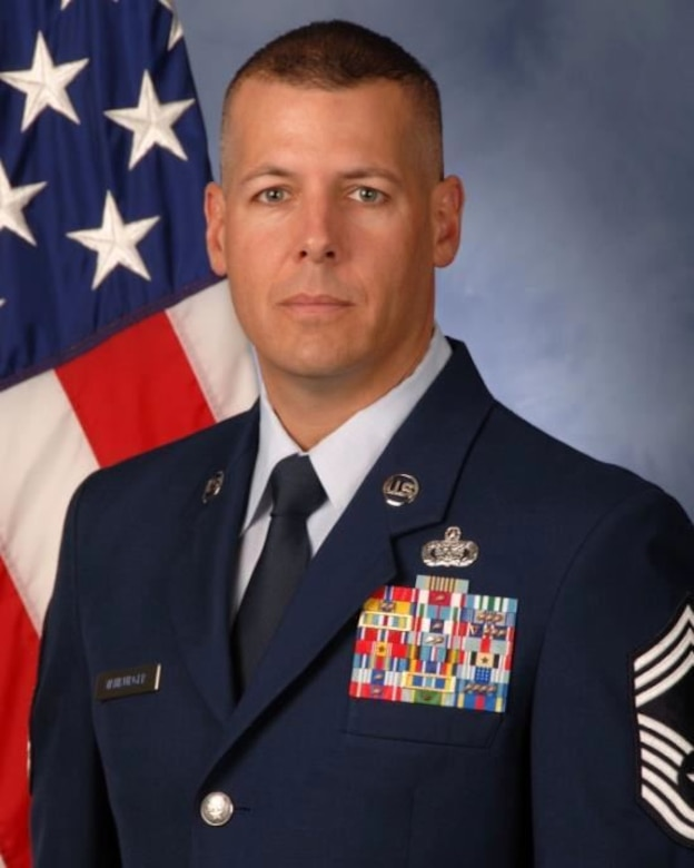 Chief Master Sgt. Christopher J. VanBurger assumes his new position as the 15th Air Force Office of Special Investigations Command Chief on Feb. 15, 2016. (Official U. S. Air Force photo)