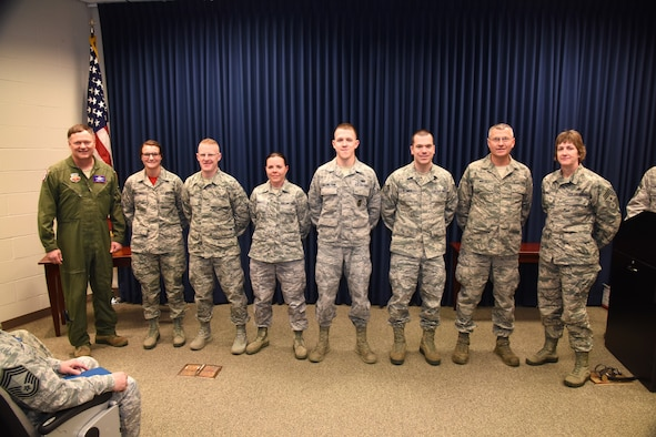 SIOUX FALLS, S.D. - Col. Russ Walz, far left, and Command Chief Master Sgt. Jeanne Gacke, far right, congratulate the 2015 Diamond Sharp award winners during a ceremony held at Joe Foss Field, S.D. Jan. 10, 2016.  Pictured recipients, left to right, Airman First Class Alexis Horstman, 114th Operations Support Squadron, Technical Sgt. Daniel Bones, 114th Civil Engineer Squadron, Technical Sgt. Jacklynn Small, 114the Logistics Readiness Squadron, Senior Airman Aaron Engebretson, 114th Security Forces Squadron, Technical Sgt. Nick Blumer, 114th Maintenance Squadron, Master Sgt. Kevin Winter, 114th Aircraft Maintenance Squadron.  Recipients not pictured are Technical Sgt. Rachel Vanbeek, 114th Medical Squadron, Senior Airman Jason Collins, 114th Mission Support Group, and Technical Sgt. Danny Oaks, HQ SDANG. (U.S. Air National Guard photo by Staff Sgt. Luke Olson/Released)