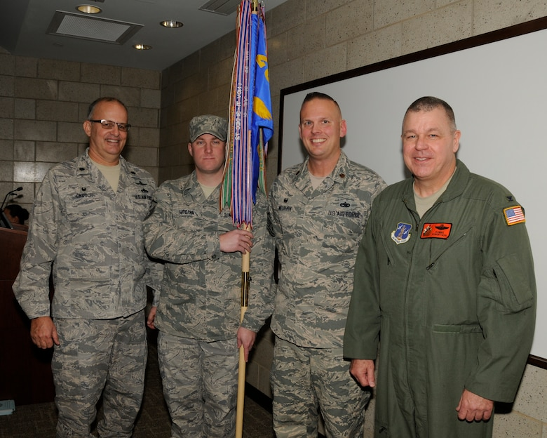 Lt. Col. Ronald Crouch (left), Master Sgt. Eric McCann, Maj. R. Thomas Nieukirk, and Col. William P. Robertson pose after the change of command ceremony for the 264th Combat Communications Squadron Jan. 9, 2016 in Peoria, Ill. Robertson, commander of the 182nd Airlift Wing, presided over the event, where Nieukirk assumed command of the squadron from Crouch. (Air National Guard photo by Tech. Sgt. Todd Pendleton)