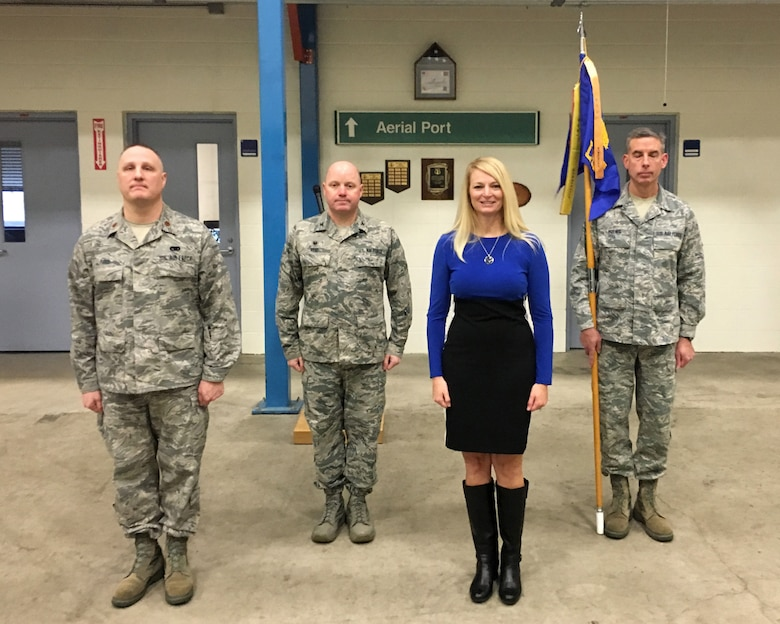 Maj. Robert Reed, left, Col. Cory Reid, Lt. Col. (Ret.) Edie O'Bryan, and Master Sgt. Steven Hoenig stand at attention prior to Reed assuming command of the 182nd Logistics Readiness Squadron from O'Bryan in a ceremony Jan. 9, 2016, in Peoria, Ill. Reid, 182nd Mission Support Group commander, presided over the event. (Air National Guard photo by Capt. Timothy Langkan)