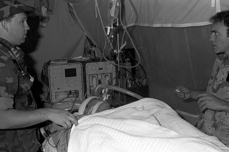 Medical personnel prepare Corporal Richard Ramirez, a member of the 1st Marine Division, for medical evacuation by a C-141B Starlifter aircraft from Al-Jubail Airport to Germany for treatment of chest wounds sustained during Operation Desert Storm. During this time, Aeromedical Evacuation teams were prepared and were able to transport up to 3,600 casualties a day.