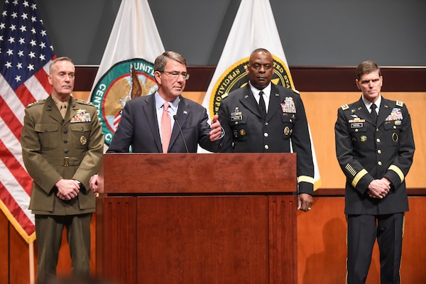 Defense Secretary Ash Carter conducts a news conference on MacDill Air Force Base in Tampa, Fla., Jan. 14, 2016. The secretary is flanked by Marine Corps Gen. Joseph F. Dunford Jr., chairman of the Joint Chiefs of Staff, left, and Army Gen. Lloyd J. Austin III, commander of U.S. Central Command.  DoD photo by Army Sgt. 1st Class Clydell Kinchen