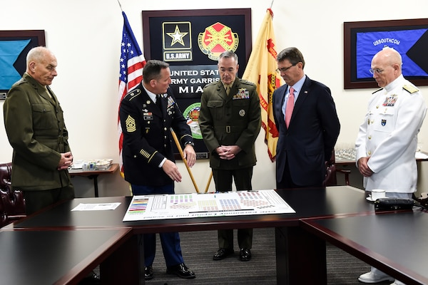 Defense Secretary Ash Carter, Marine Corps Gen. Joseph F. Dunford Jr., chairman of the Joint Chiefs of Staff,  Marine Corps Gen. John F. Kelly and Navy Adm. Kurt W. Tidd,  are all briefed by Command Sgt. Maj. William B. Zaiser before U.S. Southern Command's change-of- command ceremony in Miami, Jan. 14, 2016. DoD photo by Army Sgt. 1st Class Clydell Kinchen