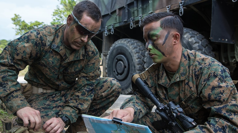 Sgt. Chad Nillo briefs Staff Sgt. Charles Higgins on possible routes to take on a patrol through the jungle Jan. 7, 2016, on Camp Hansen in Okinawa, Japan, during a three-day field training exercise. Marines with Alpha Company, Battalion Landing Team 1st Battalion, 5th Marines, 31st Marine Expeditionary Unit, were tasked with locating a simulated enemy platoon in the jungle during the training. Nillo, a squad leader with Alpha Co., BLT 1/5, 31st MEU, is from Newark, California. Higgins, a platoon sergeant with Alpha Co., BLT 1/5, 31st MEU, is from Columbia Heights, Virginia.