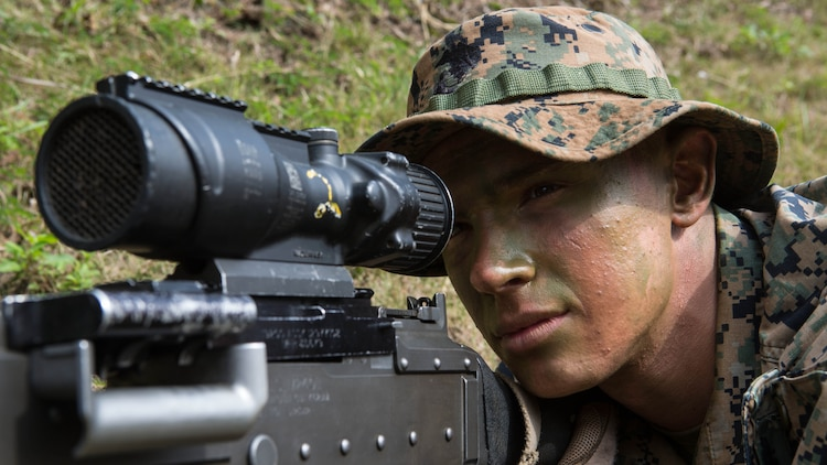 Lance Cpl. Jonathan Gilbert looks through the scope of his M240 medium machine gun while providing security for his platoon Jan. 7, 2016, on Camp Hansen in Okinawa, Japan. Marines with Alpha Company, Battalion Landing Team 1st Battalion, 5th Marines, 31st Marine Expeditionary Unit, navigated the jungles of Okinawa in search of a simulated enemy platoon. Gilbert, a machine gunner with Alpha Co., BLT 1/5, 31st MEU, is a native of Frederick, Maryland.