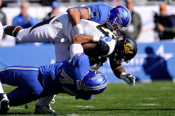 U.S. Air Force Academy defensive back Brodie Hicks, a junior, and linebacker Grant Ross, a sophomore, tackle a Cal player as the Air Force Academy Falcons met the Golden Bears of California in the Armed Forces Bowl in Fort Worth, Texas, Dec. 29, 2015. The Falcons fell to the Golden Bears 55-36. Air Force finished the season with an 8-6 overall record. (U.S. Air Force photo/ Mike Kaplan)