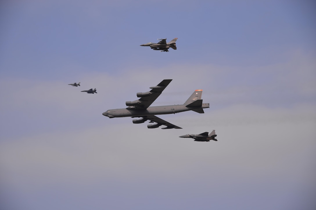 A U.S. Air Force B-52 Stratofortress from Andersen Air Force Base, Guam, conducted a low-level flight in the vicinity of Osan Air Base, South Korea, in response to recent provocative action by North Korea Jan. 10, 2016. The B-52 was joined by a South Korean F-15K Slam Eagle and a U.S. Air Force F-16 Fighting Falcon. The B-52 is a long-range heavy bomber that can fly up to 50,000 feet and has the capability to carry 70,000 pounds of nuclear or precision guided conventional ordnance with worldwide precision navigation capability. (U.S. Air Force photo/Staff Sgt. Benjamin Sutton)