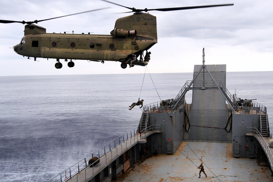 Soldiers conduct air assault operations on the deck of the 8th Theater Sustainment Command's Logistical Support Vessel-2, the Harold C. Clinger off the coast of Honolulu, Jan. 11, 2016. The soldiers are assigned to the 25th Infantry Division.