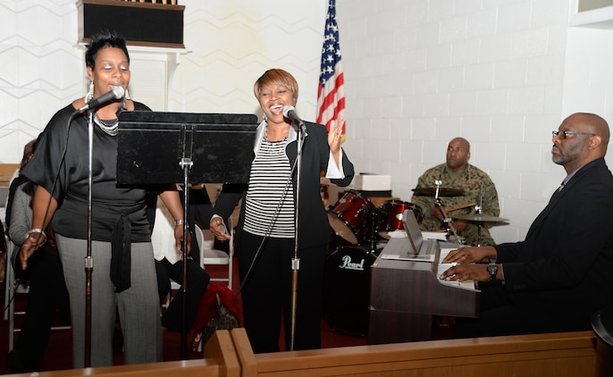 Members of the Marine Corps Logistics Base Albany Choir, Latreesa Perryman (left) and Jackie Johnson, accompanied by pianist, Steven Spraggins, entertain attendees with a duet during the installation's 2016 observance of the life and legacy of Dr. Martin Luther King Jr. The celebration, which is an annual event, was held at the installation's Chapel of the Good Shepherd, Jan. 13.