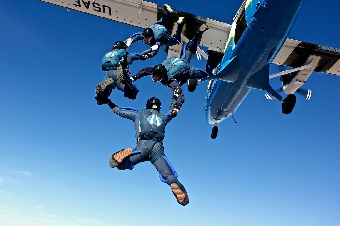 Wings of Blue team members Cadets 1st Class Jeff Herrala, Chad Sufficool, Lance Dutton and Patrick Connolly, jump from an aircraft during the Collegiate Parachuting Championships in Lake Wales Florida, Dec. 29 - Jan. 2. Wings of blue is the U.S. Air Force Academy's  parachute team. The team won 26 medals at the event. (U.S. Air Force photo)