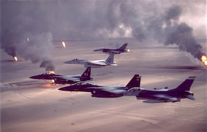 F-16A Fighting Falcon, F-15C Eagle and F-15E Strike Eagle fighter aircraft fly over burning oil field sites in Kuwait during Operation Desert Storm. (U.S. Air Force archive photo)