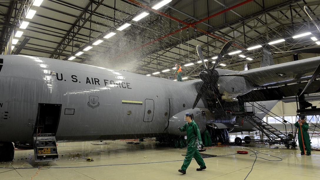 Airmen with the 86th Maintenance Squadron wash a C-130J Super Hercules before a C-2 isochronal inspection Jan. 4, 2016, at Ramstein Air Base, Germany. This examination marks the 14th and final C-2 ISO inspection for the 86th Airlift Wing until 2020. C-2 ISO inspections last approximately two weeks. (U.S. Air Force photo/Staff Sgt. Timothy Moore)